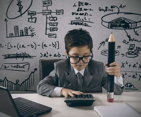 calc: Young manager works with number of the company Stock Photo