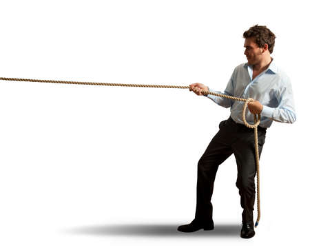 Businessman pulling rope on white background photo