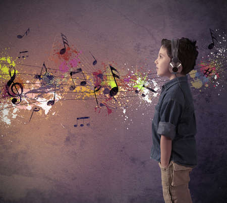 notes music: Concept of young boy listening to music