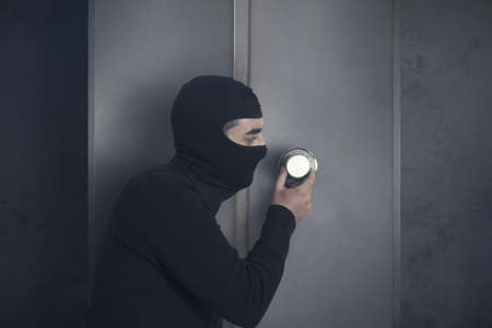 strongbox: Concept of burglar that open a strongbox Stock Photo
