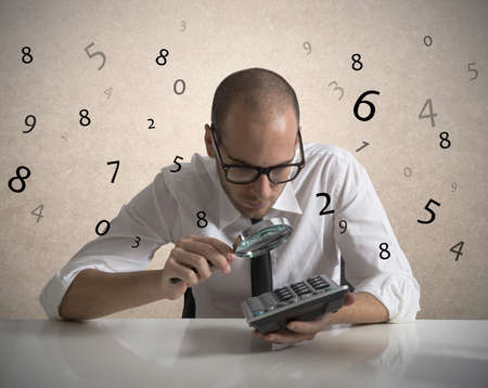 calculations: Concept of a businessman that checks the numbers and earnings