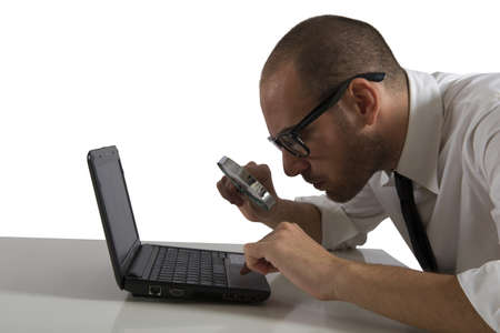 Businessman  looks on the computer with a magnifying glass Stock Photo - 17455037