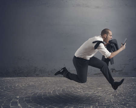 Stressed business running with tablet Stock Photo - 17534626