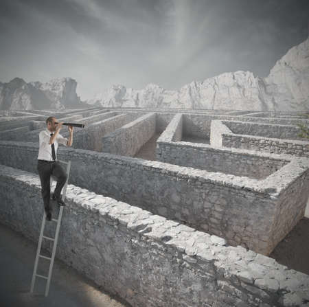 business problems: Businessman looking for the solution to the maze