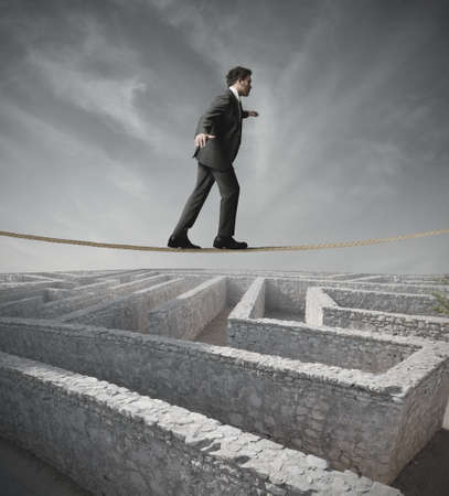 Businessman bypass the maze with the rope Stock Photo - 17534622