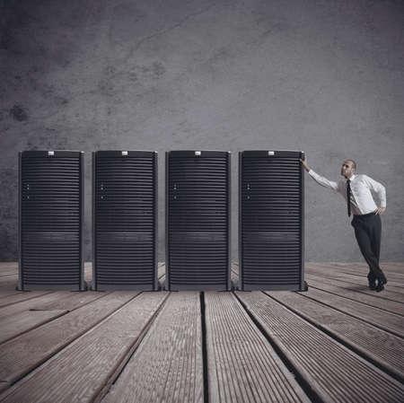 rack server: Businessman in datacenter server room