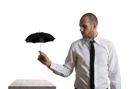Concept of business protection with umbrella Stock Photo - 17563145