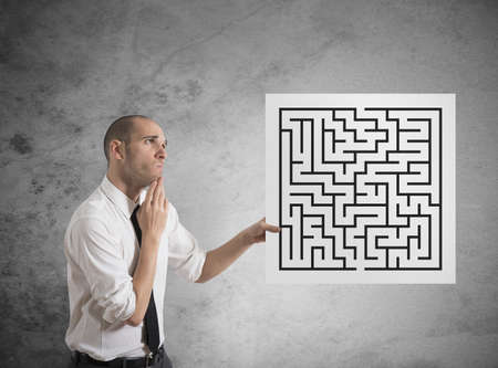 Businessman looking for a solution of a maze Stock Photo - 17563150