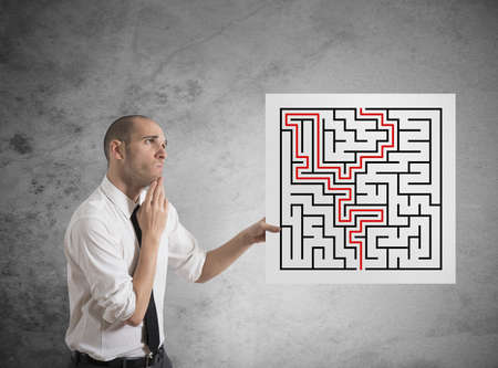 complication: Businessman with the solution of a maze