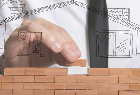 A businessman builds a new house concept Stock Photo - 17714967
