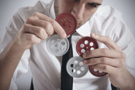 Teamwork concept with businessman working with gear Stock Photo