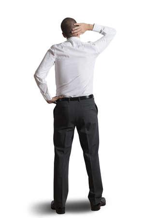 ponder: Thinking businessman isolated on white background