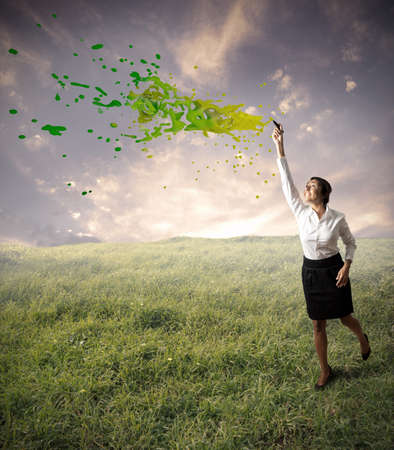 Green business concept with businessman and green spray photo