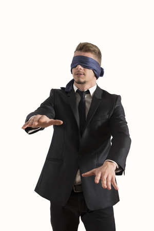 Blind businessman. Concept of difficult in business photo