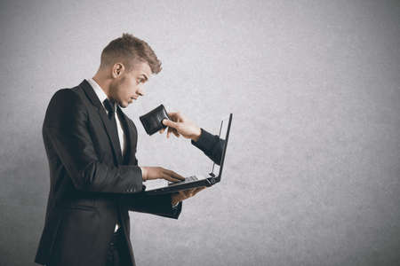 internet fraud: Concept of being robbed by a scam Stock Photo