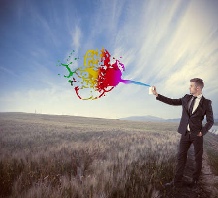 Creative in business concept with businessman and spry photo