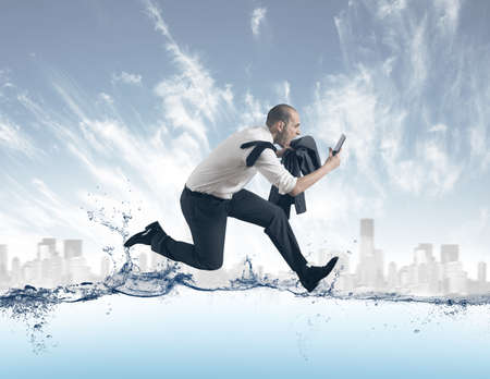 running businessman: Concept of of stress with businessman running on the water Stock Photo