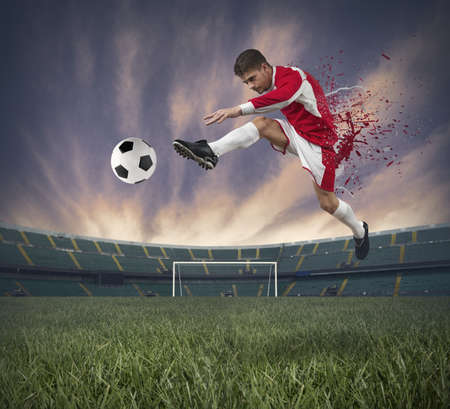 Concept of football player at stadium with spray effect photo