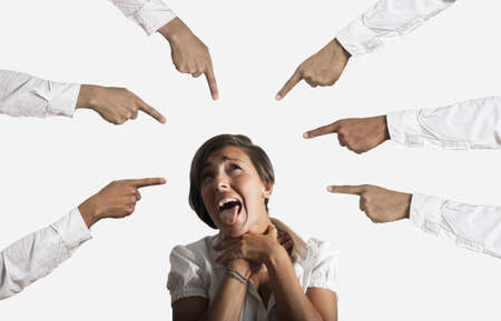 accusation: Concept of accused businesswoman with with fingers pointing on white background Stock Photo