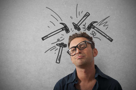 headache: Concept of stressed businessman with hammer