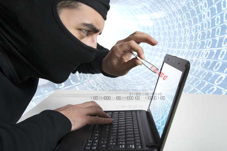Concept of hacker and virus with laptop photo