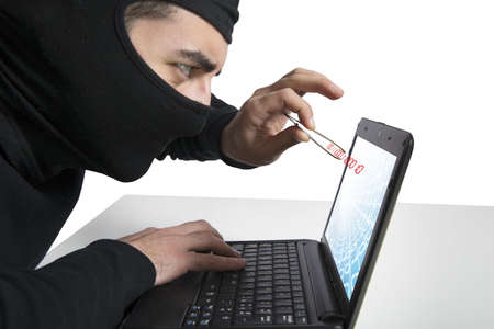 espionage: Concept of hacker and virus with laptop Stock Photo