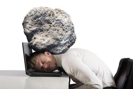 Concept of stress with businessman with a rock on the head photo