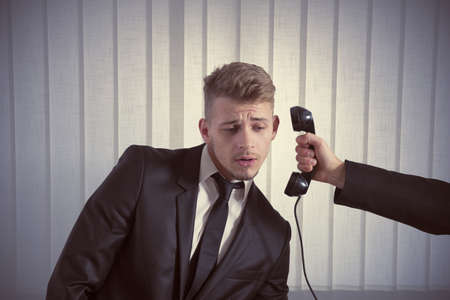 Concept of businessman surprised by a call Stock Photo - 18381192