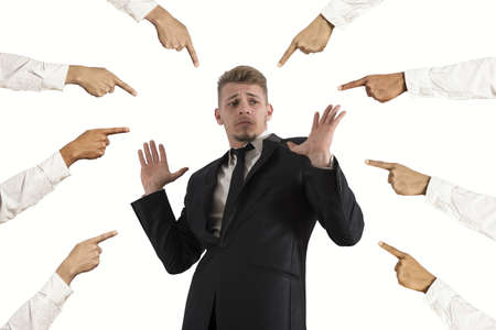 Concept of accused businessman with fingers pointing photo