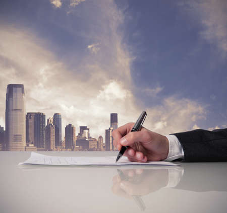 Businessman is signing a contract in office Stock Photo - 18394495