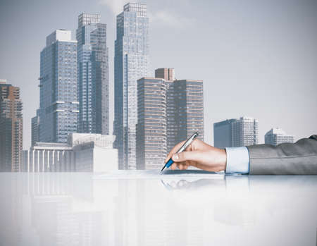 Businessman is signing a contract in office photo