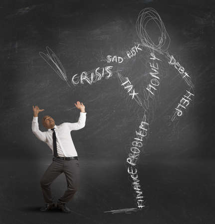 risky job: Concept of businessman oppressed by the monster of the crisis Stock Photo