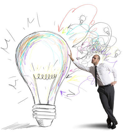 innovation concept: Concept of businessman with a creative big idea