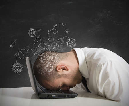 Concept of stress with businessman sleeping on a laptop Stock Photo - 18575470