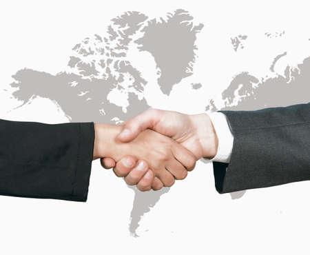 INTERNATIONAL BUSINESS: Concepto del apretón de manos de negocios del mundo