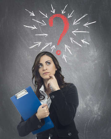 Businesswoman with a big question mark Stock Photo - 18918011