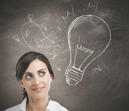 lightbulbs: Concept of a businesswoman with a big idea
