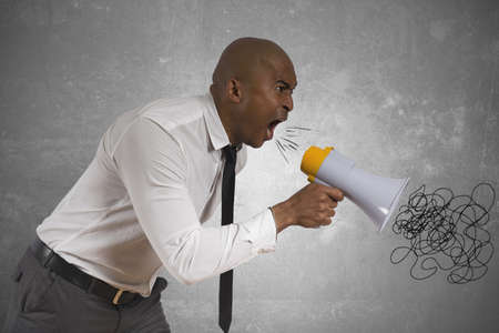 human voice: Concept of angry businessman with megaphone