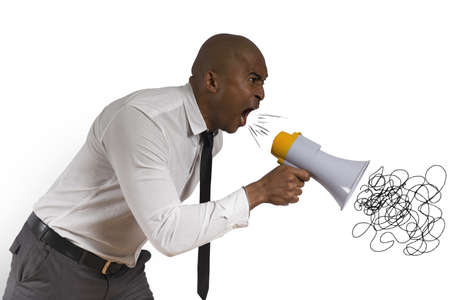 Concept of angry businessman with megaphone photo