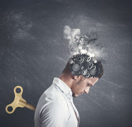 depression: Concept of stress with gear in the head of a businessman