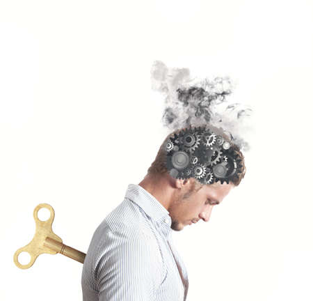 exhausting: Concept of stress with gear in the head of a businessman