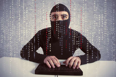 Concept of hacker at work with laptop Stock Photo - 18917933