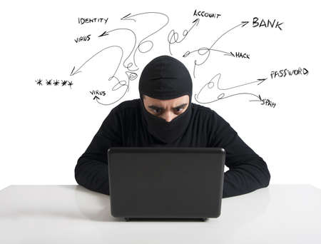 internet fraud: Concept of hacker at work with laptop