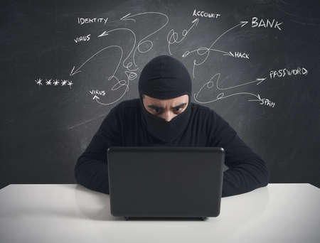 Concept of hacker at work with laptop photo