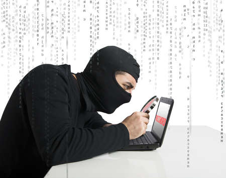 Hacker look for password in a laptop Stock Photo - 18917895