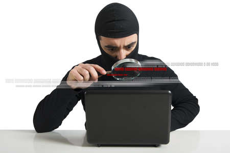 Concept of hacker at work with lens photo