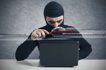 internet attack: Concept of hacker at work with lens