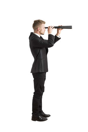 telescopes: Concept of businessman that look for the future