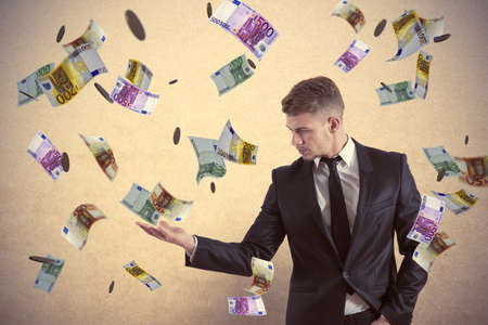 windfall: Concept of a businessman that earns money Stock Photo