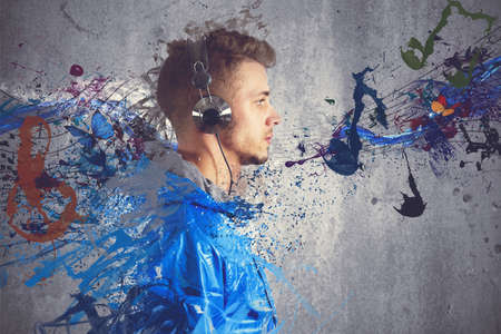 listen to music: Boy listening to music with sketch effect Stock Photo